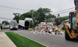 BIG MESS: Garbage truck forced to empty out on Street after fire ignites inside<br></noscript>
